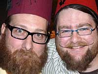 Stace and Guy each with Fez and beard