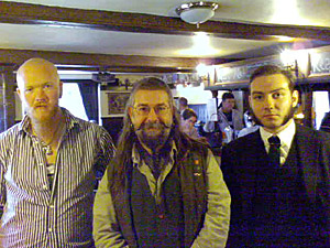 Hangover? Now it's better!? Henry, Charlie, and on the right, a gentleman, we believe, from Poland. A fine chap, pipe smoker, and potential future member